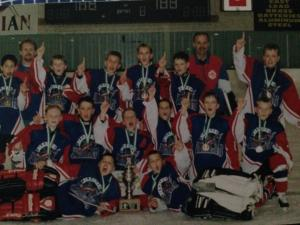 (Photo: Carson Shields is last on the top row. Jonathan Toews is second row, second from the left)
