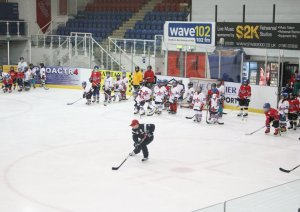 Hughes taking the time to help out at a hockey camp in Scotland.